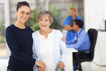 Stock photo of woman with an elderly patient in a medical setting