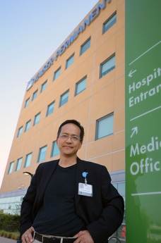 Honored Instructor Stephen Wong in front of Kaiser hospital