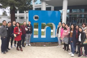 A group of BHGAP students posing in front of the Linkedin sign at the headquarters in Sunnyvale.