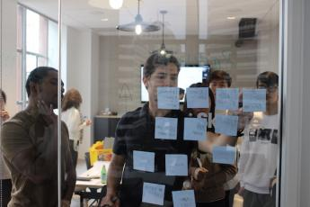 BHGAP students brainstorm with post its