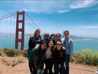 Iris Ye visits the Golden Gate Bridge and poses with friends from BHGAP