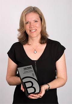 Heather Paulsen holding B Corp award