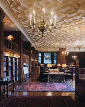 a beautiful campus library with carpets and chandeliers