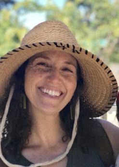 Dana Neufeld wearing a sun hat and smiling