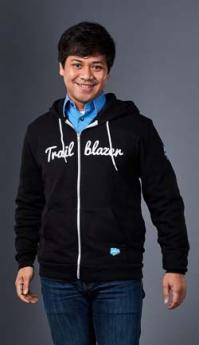 Portrait of Joshua Lanada in black jacket and blue jeans
