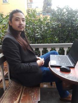 Medical writer Kevin Chen at his laptop
