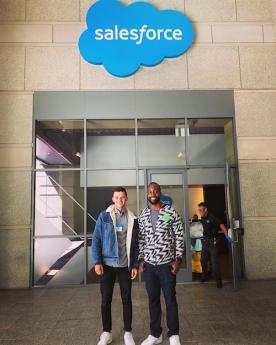 BHGAP student Marcel poses in front of the Salesforce sign
