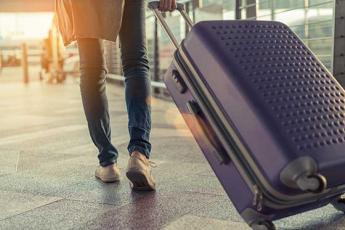 Photo of woman toting a suitcase at the airport