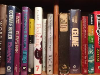 Bookshelf that includes authors such as Octavia Butler, Truman Capote and Italo Calvino
