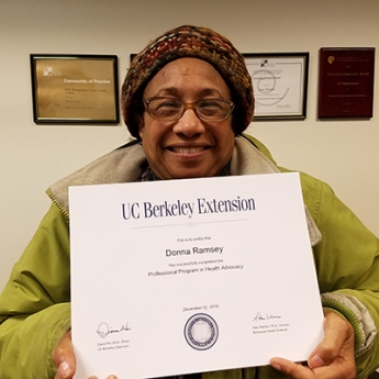 Donna Ramsey holds her Health Advocacy certificate
