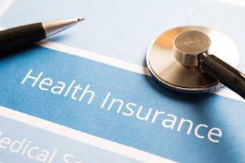 Health Insurance paper and pen