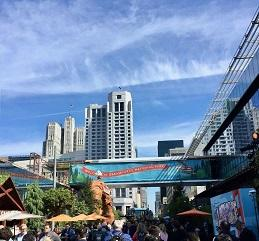 San Francisco skyline rises above signs for Dreamforce conference