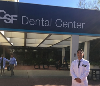 Kyle Takahashi stands outside of the UCSF Dental School