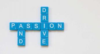 tiles spelling out passion and drive
