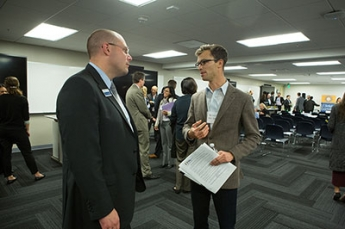 Photo of two attendees networking at event
