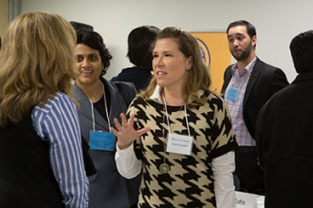 Sabrina Lowell chatting with attendees