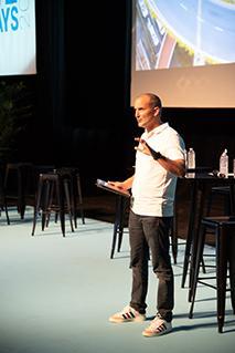 Matthieu Bonenfant onstage addressing a crowd