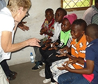 Stasi teaches ASL to deaf camp students in Africa