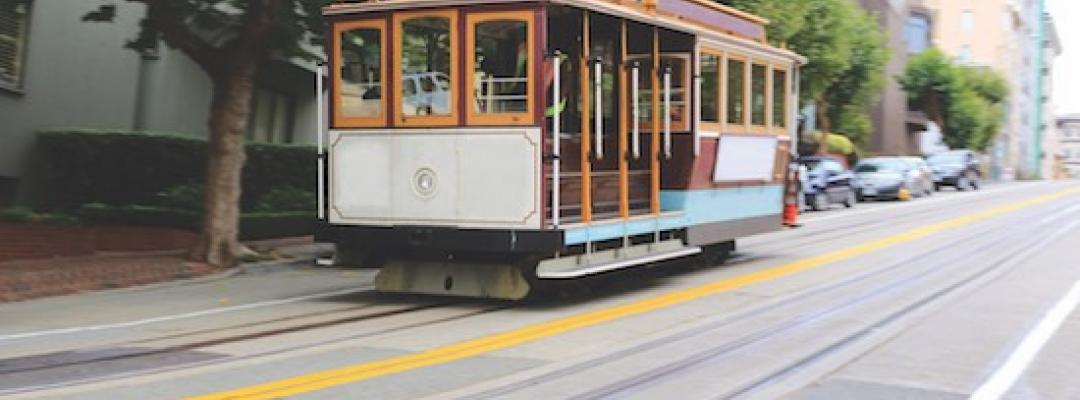 An iconic San Francisco cable car pictured on a city street.