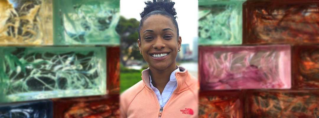 Photo of Ysis Tarter wearing a salmon-colored hoodie