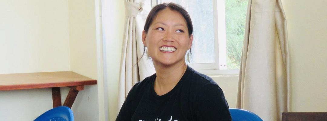 Trauma-Informed Interventions program graduate Amy Paulson smiling, not looking at camera. Photo.
