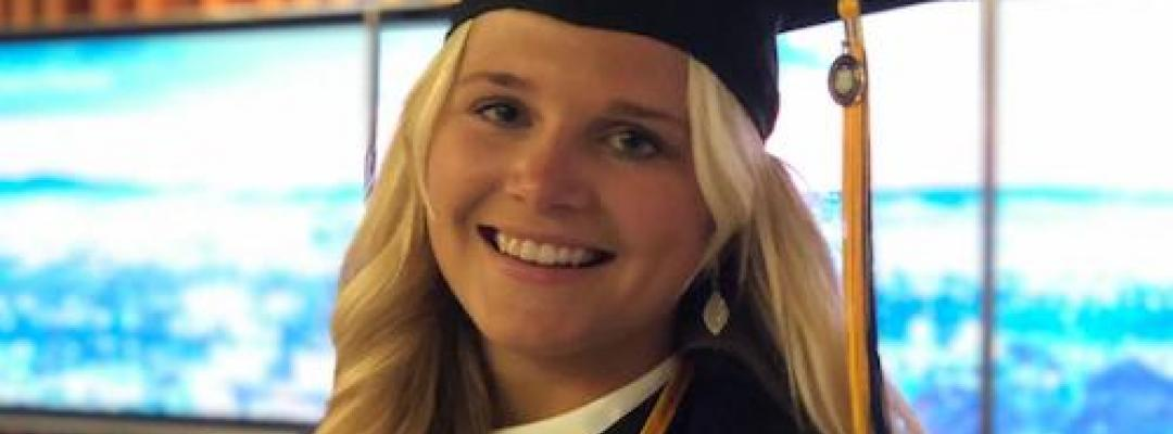 Anna Julia in her graduation cap and gown at the BHGAP closing ceremony