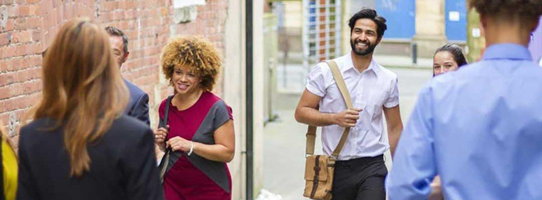 Young professionals walking down an alleyway