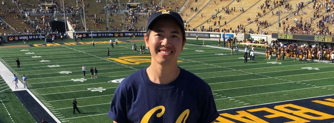 BGA Discover student Dan Pham from Copenhagen poses with this UC Berkeley gear at a football game.