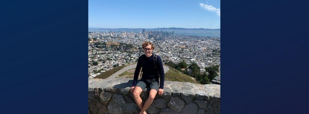 BHGAP student Frederic Bock visits San Francisco's Twin Peaks and poses in front of a view of the city