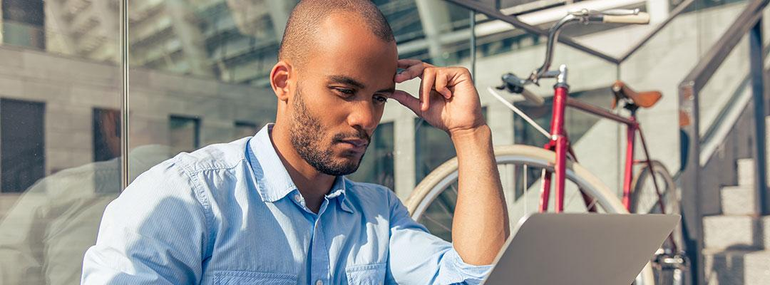 Stock photo of career changer looking at job listings