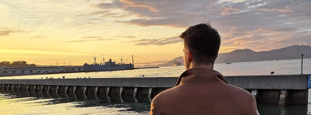 BHGAP student Markus looks out at the San Francisco Bay during sunset