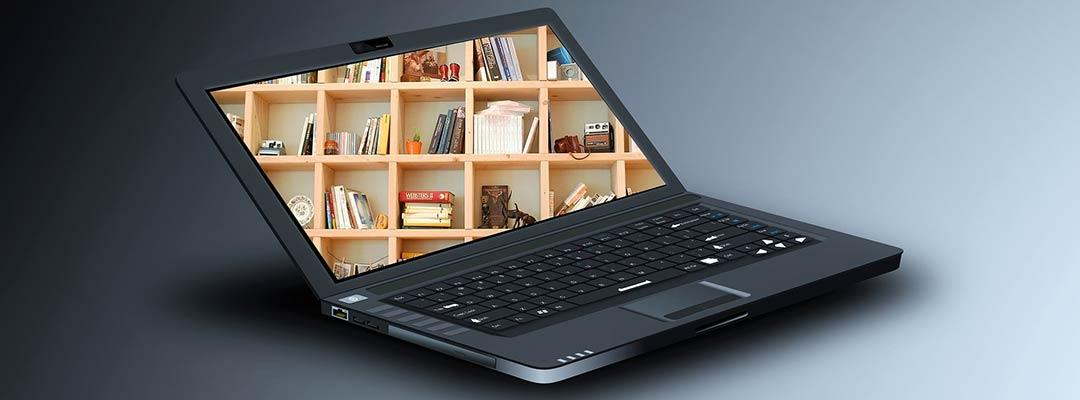 Stock photo of a black laptop open with a wooden bookcase filling the screen