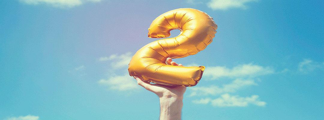 photo of hand holding a number 2 balloon
