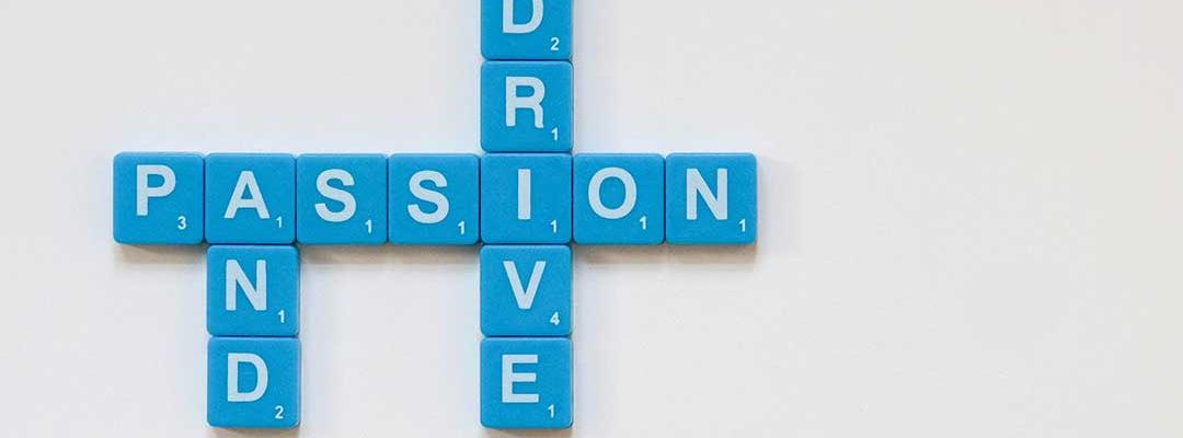 Photo of tiles spelling out Passion and Drive