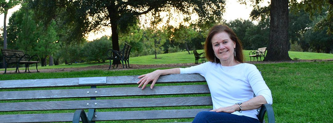 Editing program graduate Stephanie Martch sitting on a park bench in Texas
