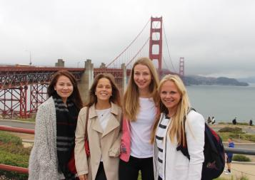 BHGAP student Anna Julia from Germany poses in front of the Golden Gate bridge on a foggy day with classmates.