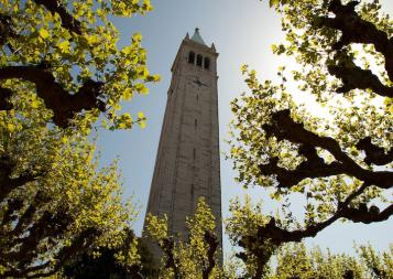 UC Berkeley's famous campanille bell tower framed by trees on campus