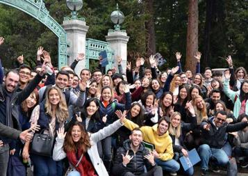 Photo of group of international students in front of UC Berkeley Sather Gate