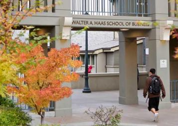 Photo of students walking under Haas School of Business archway
