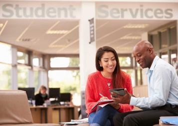 college adviser working with young student