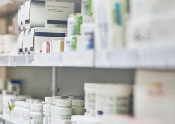A shelf full of pharmaceutical products