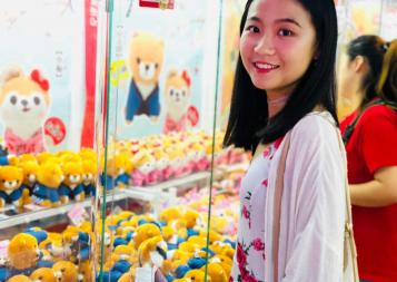 Photo of Simin Yu at a toy booth