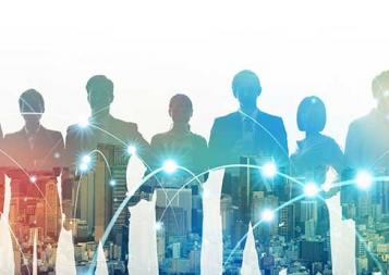Scaled back image of multiple business people standing in front of a city skyline