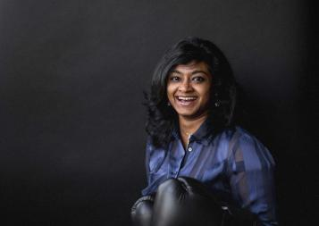 Data Science graduate Swathi Annamalai with boxing gloves on