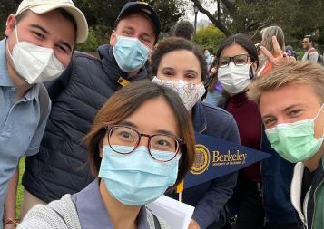Group selfie of international students wearing masks on UC Berkeley campus