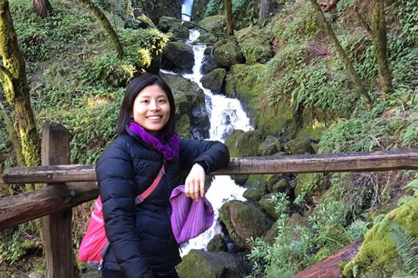 Interior designer Julia Chang posed in front of a waterfall