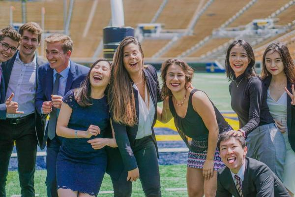 Karin and BHGAP grads pose for a photo on the Cal football field