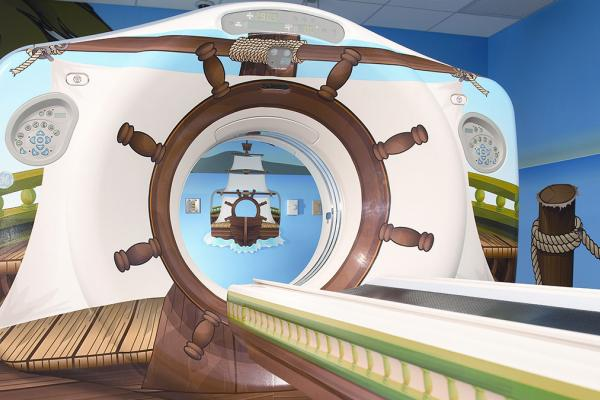 MRI machine decorated like a ship to help children relax