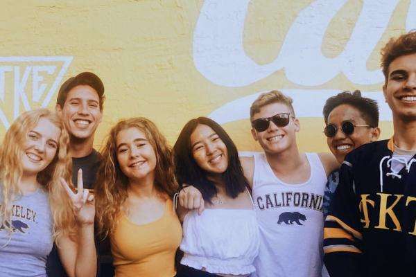 Berkeley undergraduates happily pose in their Cal gear.