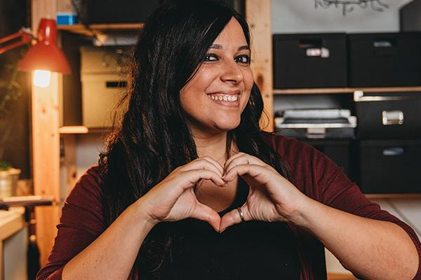 Italian American woman making a heart with her hands